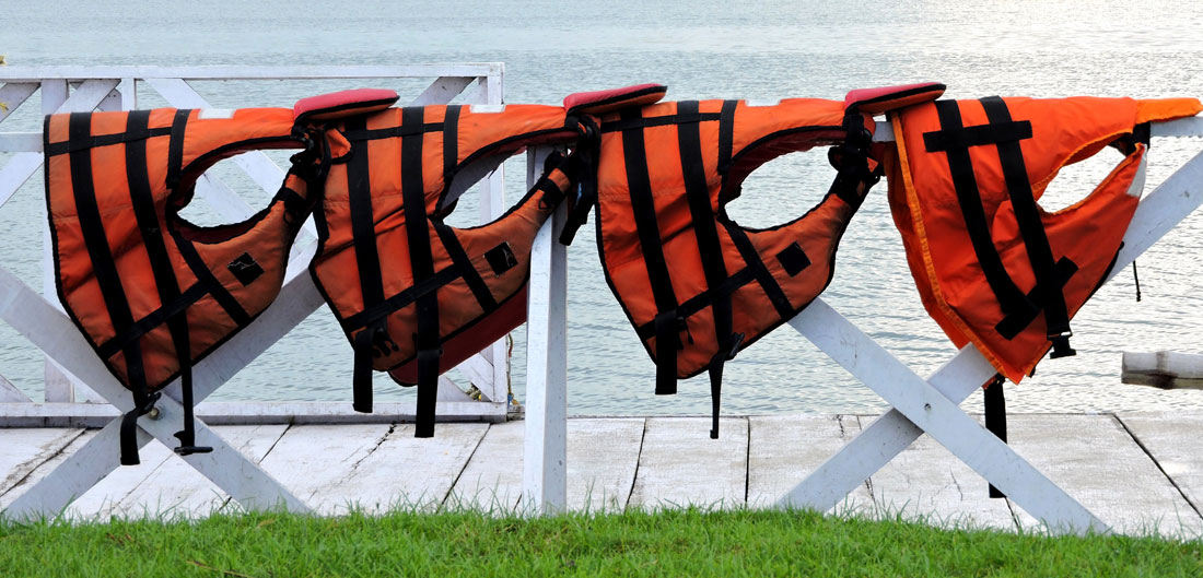 life jackets hanging in a row