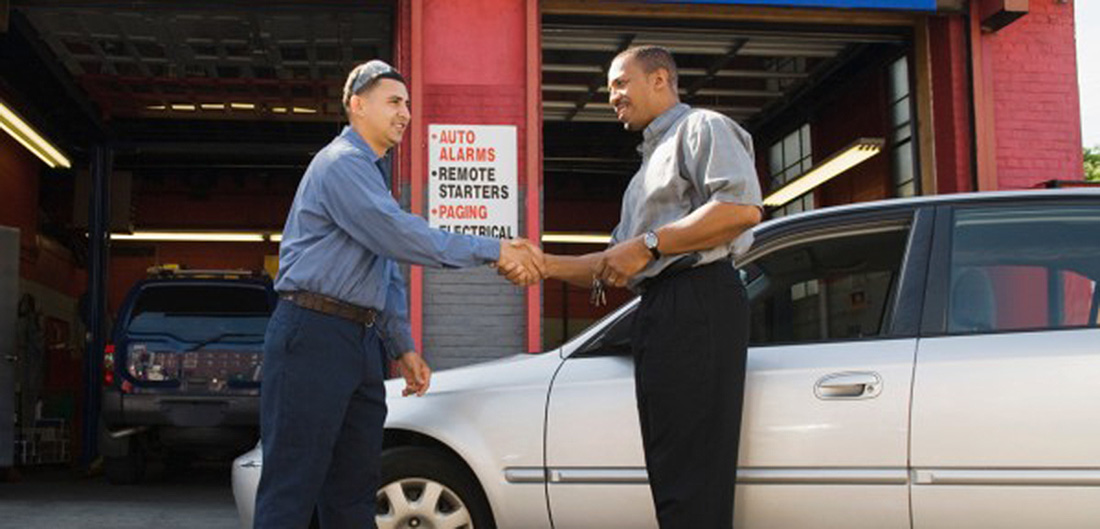 men shaking hands at auto repair shop