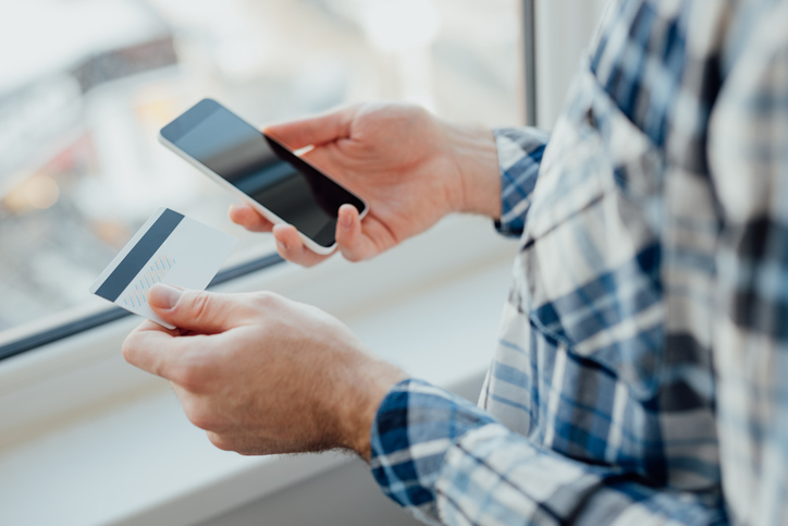 entering credit card information into smartphone