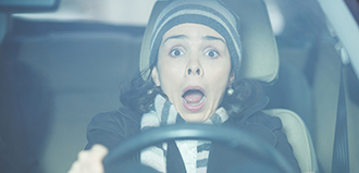 startled woman driving