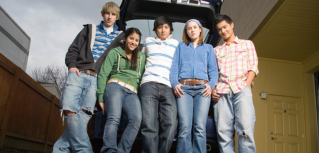 teens posing with car