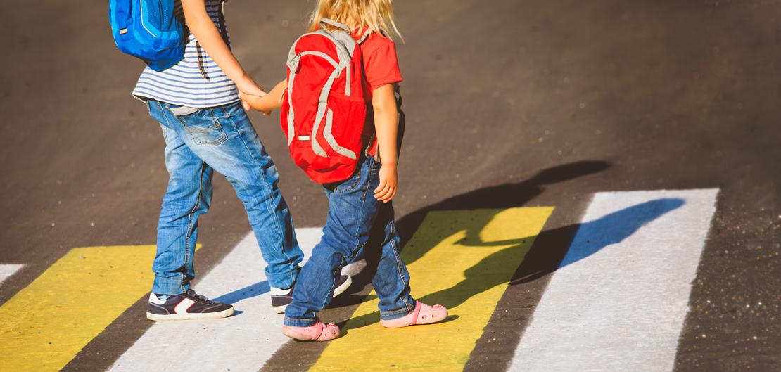 Children walking in crosswalk