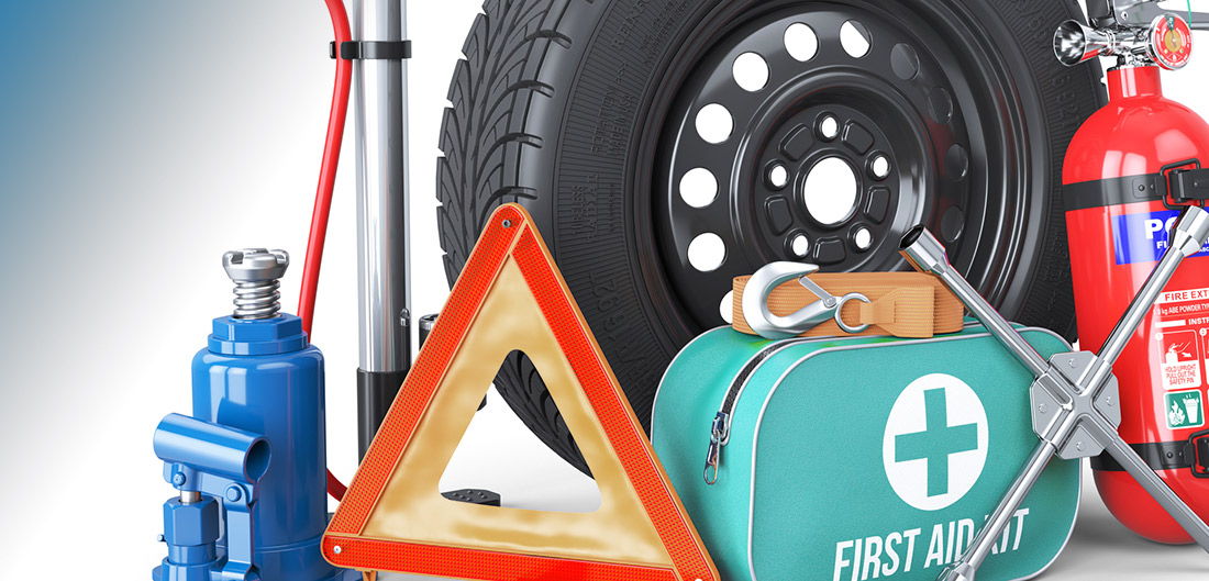 Spare tire, fire extinguisher, first aid kit, and road reflector for car emergencies