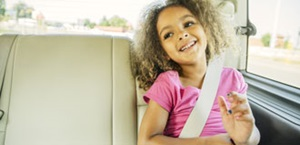 little girl rides in car
