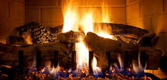 logs burn in cozy fireplace