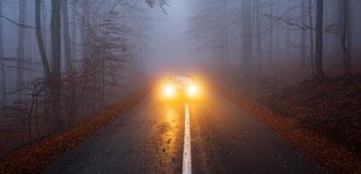 headlights from car on foggy street