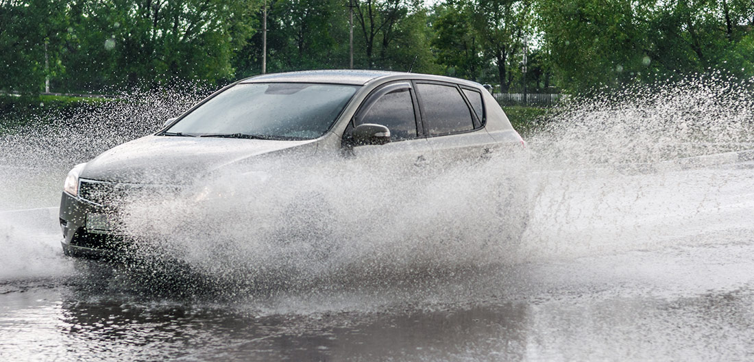 car driving through standing water