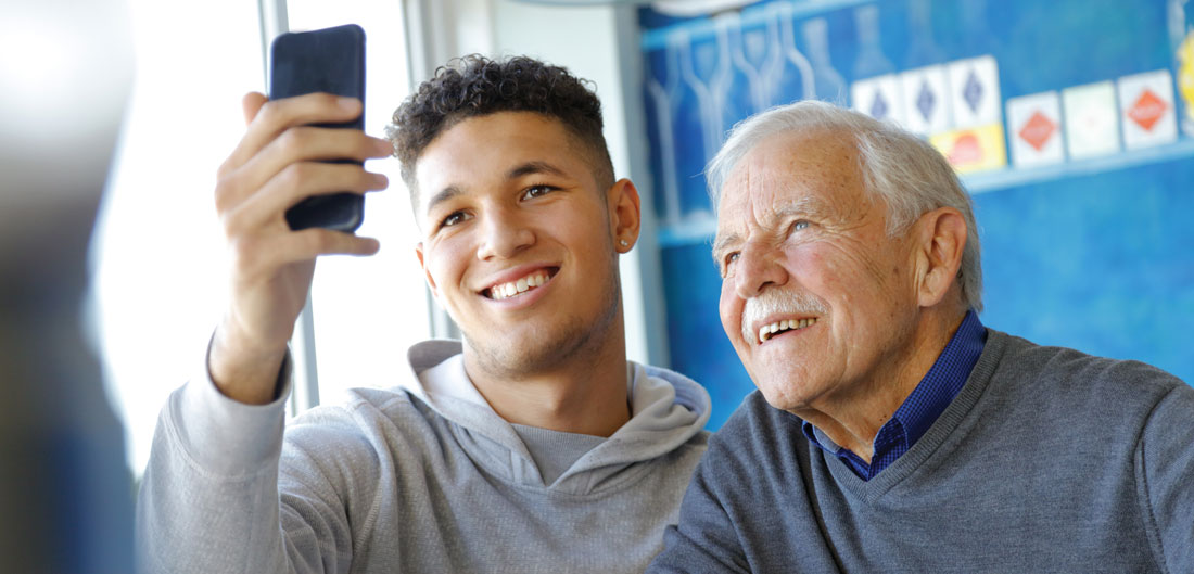grandson and grandfather take a selfie