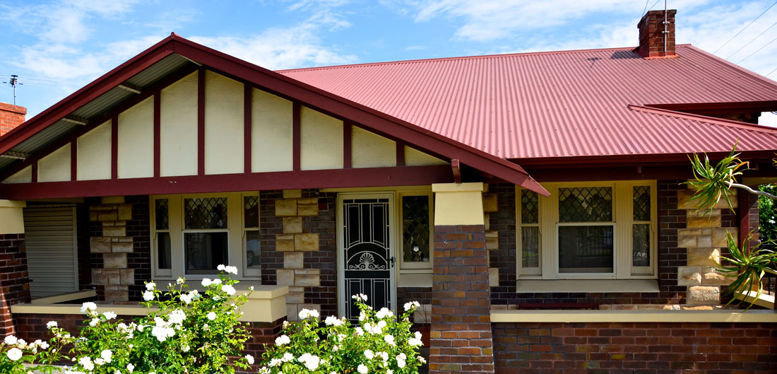 bungalow style home with metal roof