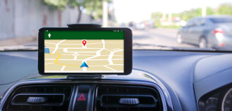 GPS map displays on mobile phone on car dashboard