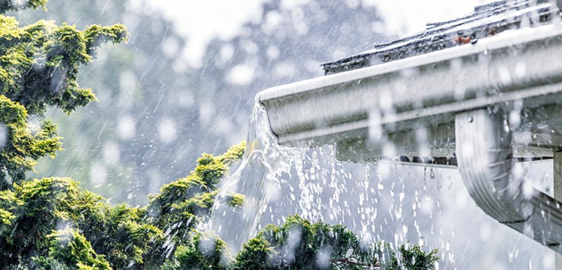 a rainy filled gutter