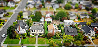 miniature houses depict suburban neighborhood