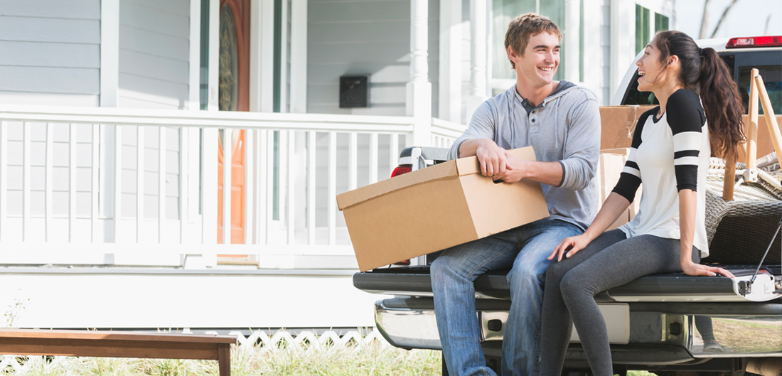 a man and a woman sitting in a truck