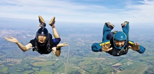 two skydivers fall in midair