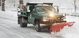 snowplow pushes snow off road