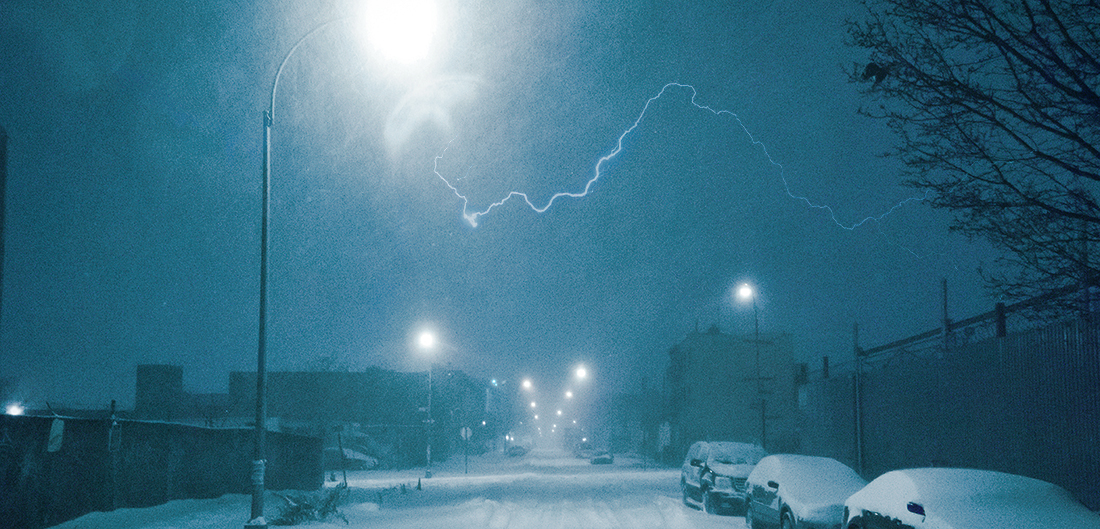 lightning bolt flashes across snowy sky