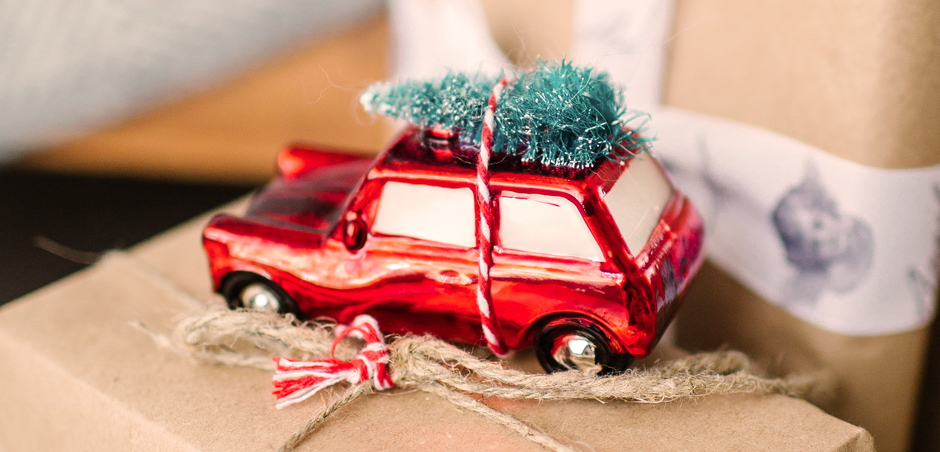 close-up of small toy car on top of wrapped present