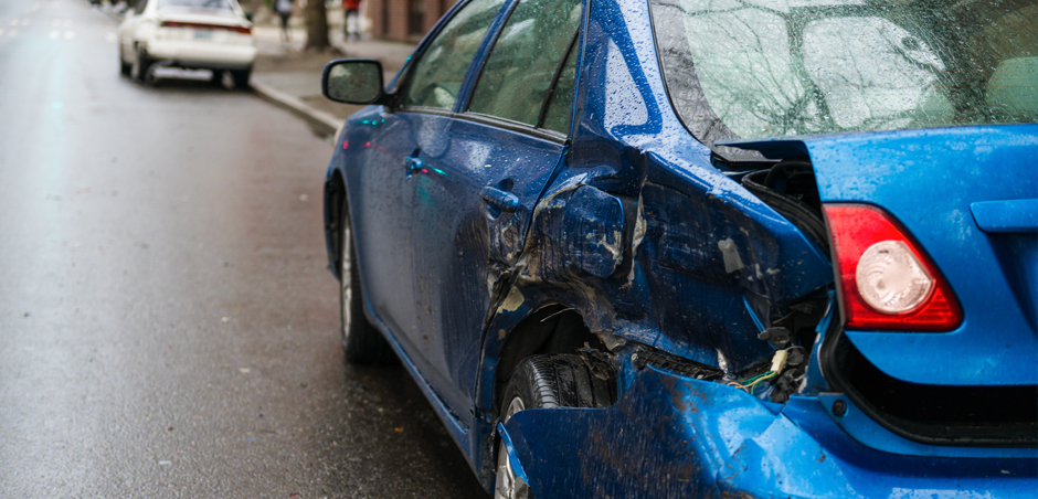 parked car has dent in rear driver's side door