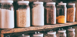 spice jars are lined up in pantry