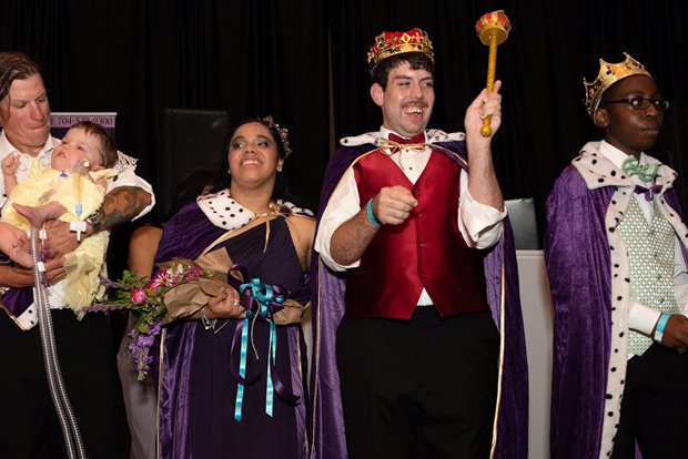 prom king is crowned and surrounded by other court at sandbox prom
