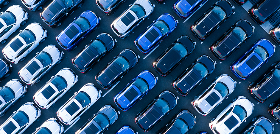 aerial view of many cars parked in lot