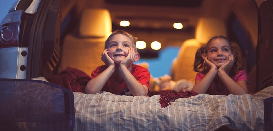 Kids watching movie at drive-in theatre