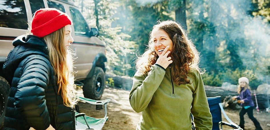 Women standing near an RV