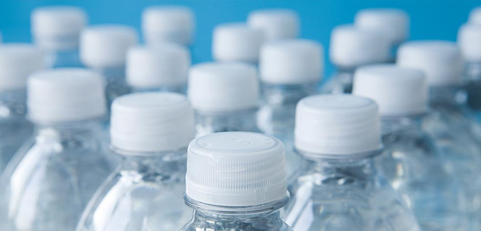 close-up of 18 water bottles with sealed caps