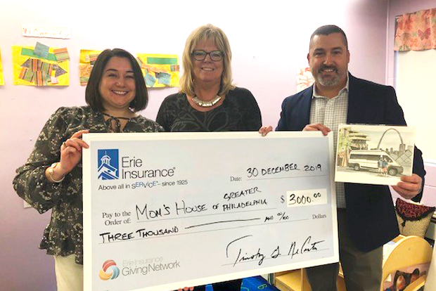 Lauren DiSantis, an ERIE district sales manager in the Allentown Branch; Wendy McKeon, executive director of Mom's House; and Jeff Wentzel, ERIE agent present a $3,000 check from ERIE's Giving Network to Mom's House Of Greater Philadelphia.