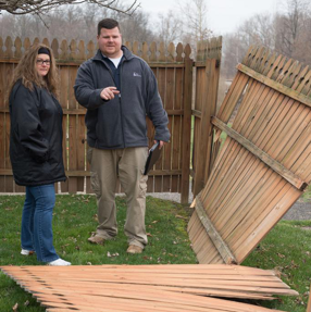 Allentown Catastrophe property adjuster Brendan meets with a homeowner after a storm damaged her property.