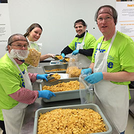ERIE Employees preparing food