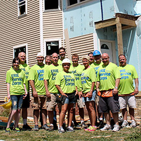 ERIE Employees standing in front of Habitat for Humanity build