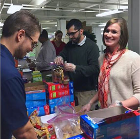 Erie Employees preparing care packages