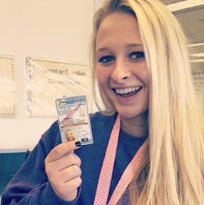 Young driver Maddi shows off her driver license