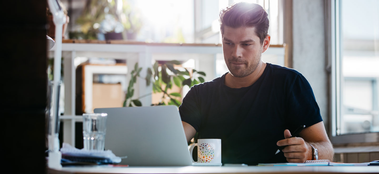 Man working from home on a laptop at a desk